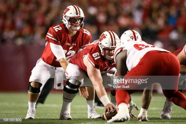 Alex Hornibrook of the Wisconsin Badgers lines up for a play in the third quarter against the Nebraska Cornhuskers at Camp Randall Stadium on October...
