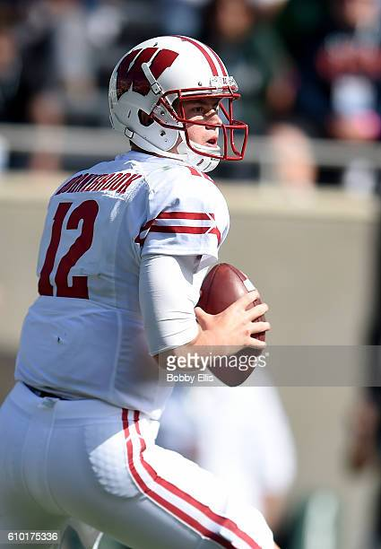 Alex Hornibrook of the Wisconsin Badgers looks for a receiver downfield during the game against the Michigan State Spartans at Spartan Stadium on...