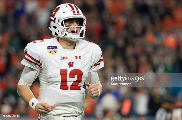 Alex Hornibrook of the Wisconsin Badgers looks on during the 2017 Capital One Orange Bowl against the Miami Hurricanes at Hard Rock Stadium on...