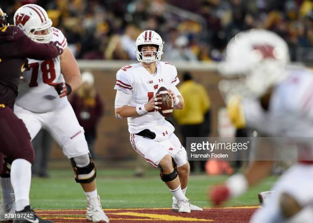 Alex Hornibrook of the Wisconsin Badgers looks to passes the ball against the Minnesota Golden Gophers during the third quarter of the game on...