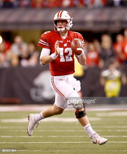 Alex Hornibrook of the Wisconsin Badgers looks to throw a pass against the Ohio State Buckeyes in the Big Ten Championship at Lucas Oil Stadium on...
