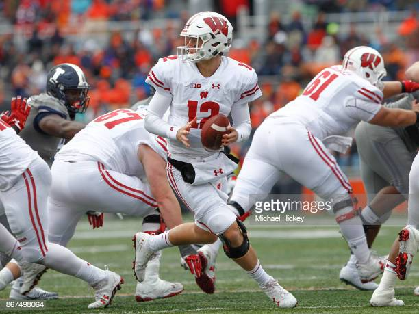 Alex Hornibrook of the Wisconsin Badgers rolls out of the pocket to pass during the game against the Illinois Fighting Illini at Memorial Stadium on...