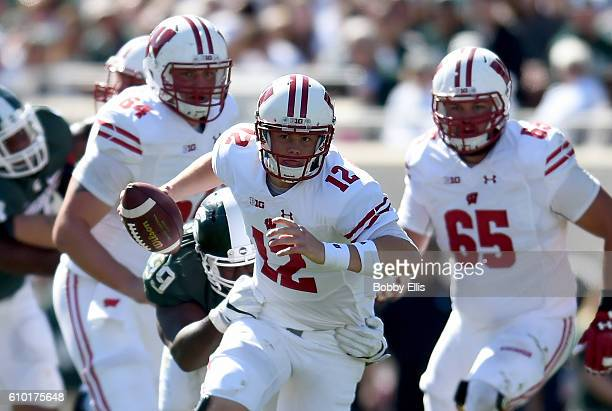 Alex Hornibrook of the Wisconsin Badgers runs with the ball during the game against the Michigan State Spartans at Spartan Stadium on September 24...