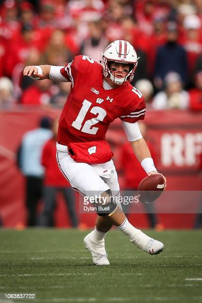Alex Hornibrook of the Wisconsin Badgers scrambles in the first quarter against the Rutgers Scarlet Knights at Camp Randall Stadium on November 03...