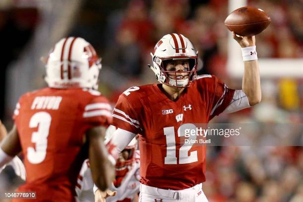 Alex Hornibrook of the Wisconsin Badgers throws a pass in the first quarter against the Nebraska Cornhuskers at Camp Randall Stadium on October 6...