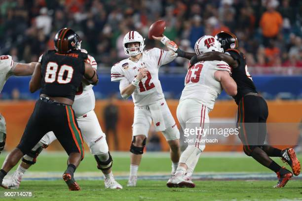 Alex Hornibrook of the Wisconsin Badgers throws the ball against the Miami Hurricanes during the 2017 Capital One Orange Bowl at Hard Rock Stadium on...