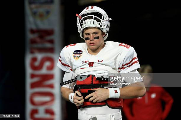 Alex Hornibrook of the Wisconsin Badgers warms up during the 2017 Capital One Orange Bowl against the Miami Hurricanes at Hard Rock Stadium on...