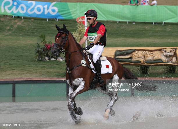 Alex Hua Tian of China on horse Don Geniro in action during the Eventing Cross Country of the Equestrian events at the Rio 2016 Olympic Games at the...