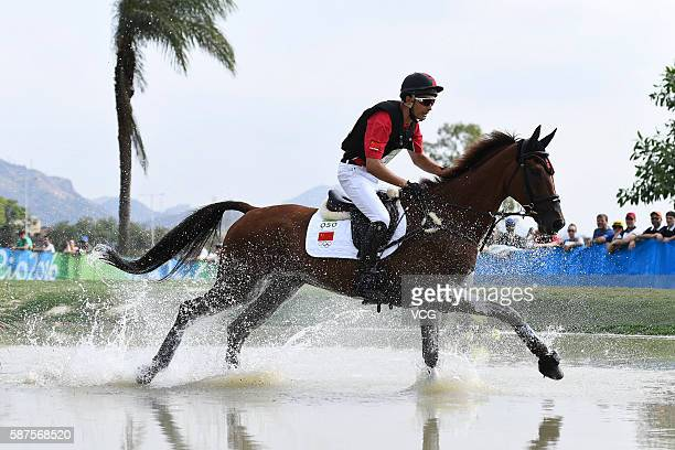 Alex Hua Tian of China riding Don Geniro competes during the Cross Country Eventing on Day 3 of the Rio 2016 Olympic Games at the Olympic Equestrian...