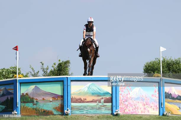 Alex Hua Tian of Team China riding Don Geniro clears a jump during the Eventing Cross Country Team and Individual on day nine of the Tokyo 2020...