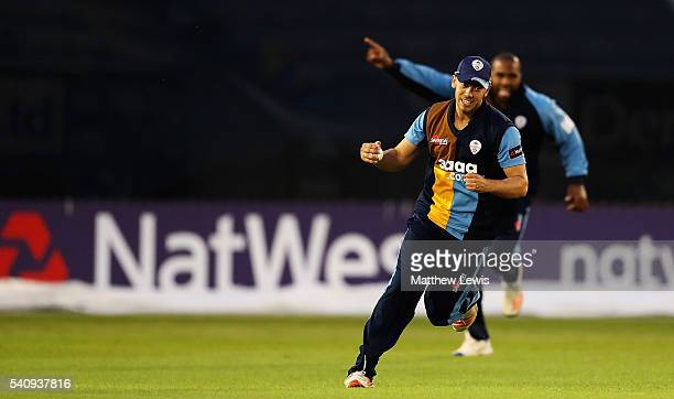 Alex Hughes of Derbyshire celebrates catching Sam Hain of Warwickshire during the NatWest T20 Blast match between Derbyshire and Warwickshire at The...