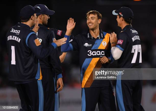 Alex Hughes of Derbyshire Falcons celebrates the wicket of Ben Duckett of Northamptonshire Steelbacks during the Vitality Blast match between...