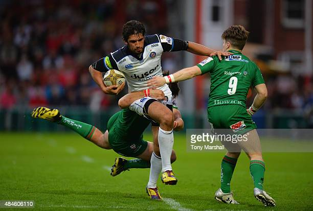 Alex Humphries of Bath Rugby is tackled by Ross Neal and Rory Brand of London Irish during the Singha Premiership Rugby 7s Series Gloucester at...