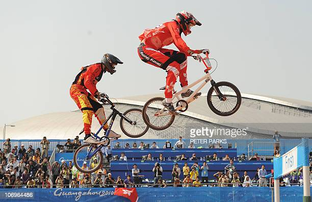 Alex Hunter of Hong Kong leads Zhao Zhiyang of China in the men's BMX final at the 16th Asian Games in Guangzhou on November 19 2010 Steven Wong of...