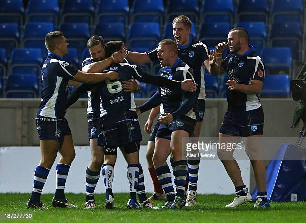 Alex Hurst of Scotland celebrates his try with Danny Brough during the Rugby League World Cup InterGroup match between Scotland and United States at...