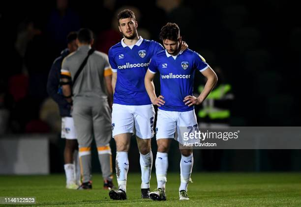 Alex Iacovitti and Rob Hunt of Oldham Athletic react at the end of the game during the Sky Bet League Two match between Newport County and Oldham...