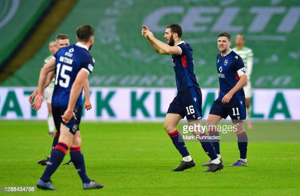 Alex Iacovitti of Ross County celebrates with teammate Iain Vigurs after scoring their team's second goal during the Betfred Cup match between Celtic...