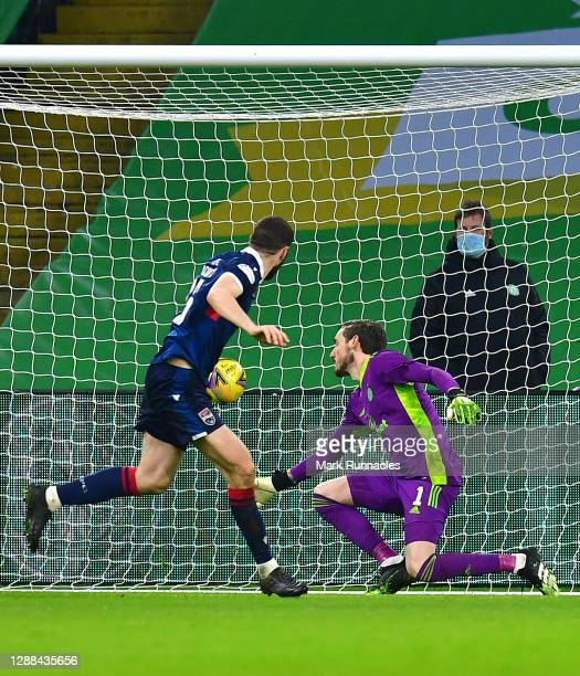 Alex Iacovitti of Ross County scores their sides second goal past Vasilis Barkas of Celtic during the Betfred Cup match between Celtic and Ross...