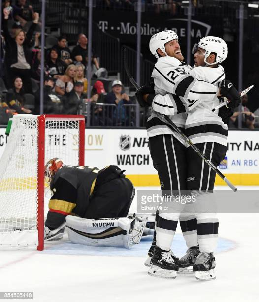 Alex Iafallo of the Los Angeles Kings hugs temmate Brooks Laich after he scored a gamewinning goal in overtime against Calvin Pickard of the Vegas...