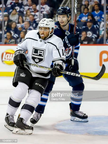 Alex Iafallo of the Los Angeles Kings and Jacob Trouba of the Winnipeg Jets keep an eye on the play during third period action at the Bell MTS Place...