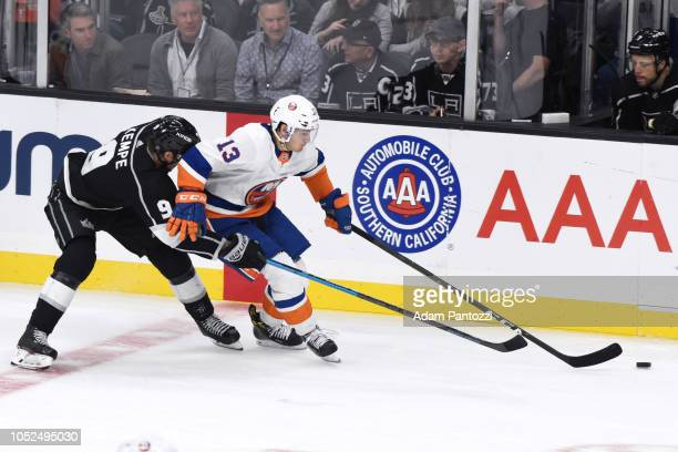 Alex Iafallo of the Los Angeles Kings and Mathew Barzal of the New York Islanders battle for the puck during the second period of the game at STAPLES...
