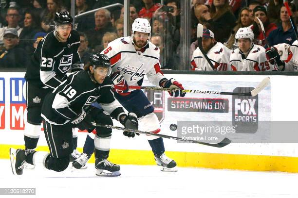 Alex Iafallo of the Los Angeles Kings and Michal Kempny of the Washington Capitals fight for control of the puck during the first period at Staples...