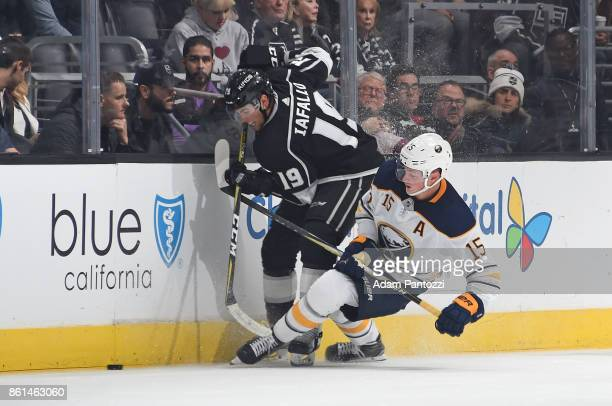 Alex Iafallo of the Los Angeles Kings battles for the puck against Jack Eichel of the Buffalo Sabres at STAPLES Center on October 14 2017 in Los...
