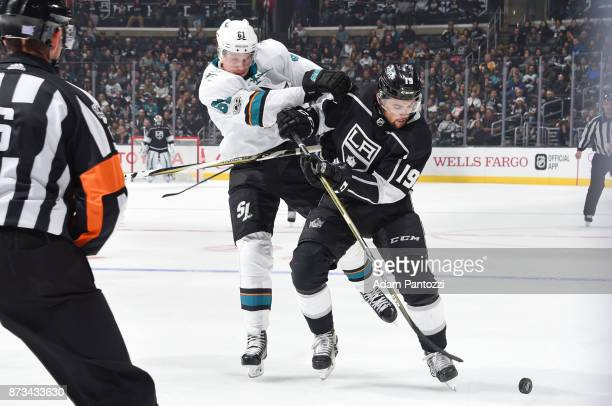 Alex Iafallo of the Los Angeles Kings battles for the puck against Justin Braun of the San Jose Sharks at STAPLES Center on November 12 2017 in Los...
