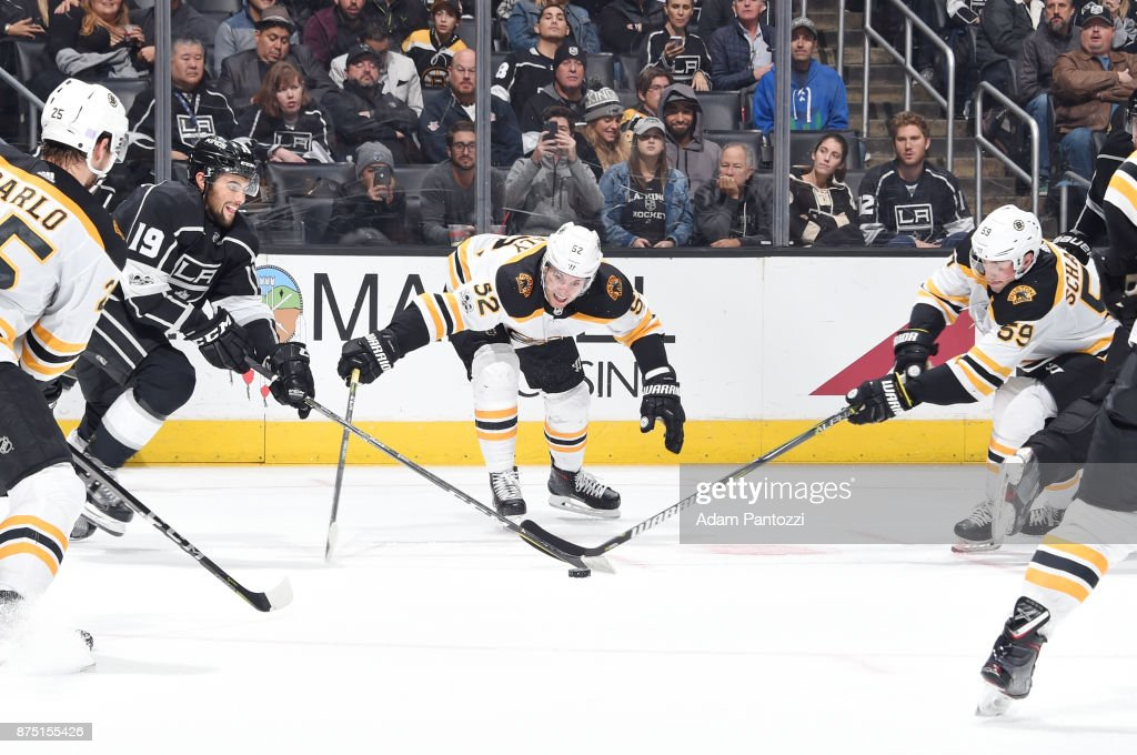 Alex Iafallo #19 of the Los Angeles Kings battles for the puck against Sean Kuraly #52 and Tim Schaller #59 of the Boston Bruins at STAPLES Center on November 16, 2017 in Los Angeles, California.