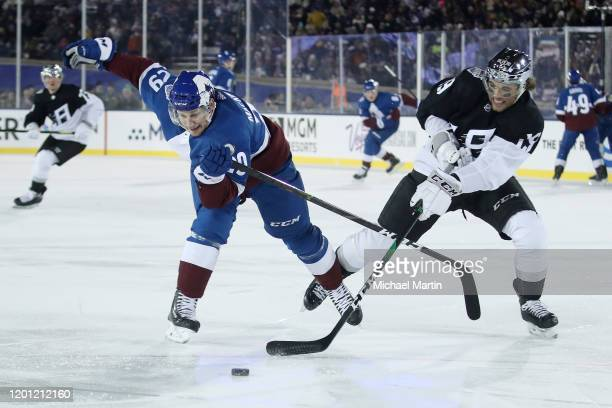 Alex Iafallo of the Los Angeles Kings defends against Nathan Mackinnon of the Colorado Avalanche at Falcon Stadium on February 15, 2020 in Colorado...