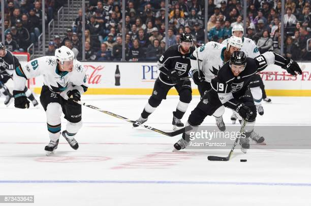 Alex Iafallo of the Los Angeles Kings handles the puck against Justin Braun of the San Jose Sharks at STAPLES Center on November 12 2017 in Los...