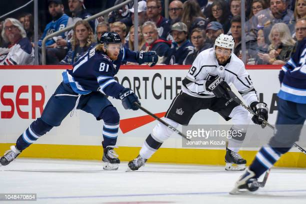 Alex Iafallo of the Los Angeles Kings plays the puck down the ice as Kyle Connor of the Winnipeg Jets gives chase during first period action at the...