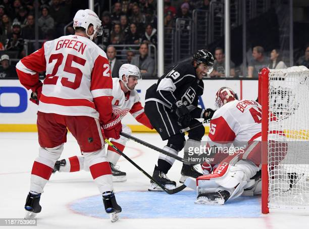 Alex Iafallo of the Los Angeles Kings scores a game winning goal between Jonathan Bernier, Dylan Larkin and Mike Green of the Detroit Red Wings...