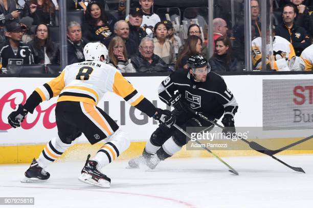 Alex Iafallo of the Los Angeles Kings skates against Brian Dumoulin of the Pittsburgh Penguins at STAPLES Center on January 18 2018 in Los Angeles...