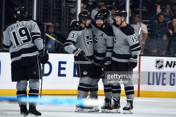 Alex Iafallo of the Los Angeles Kings, Tyler Toffoli, Drew Doughty and Ben Hutton celebrate a goal during the third period against the Nashville...