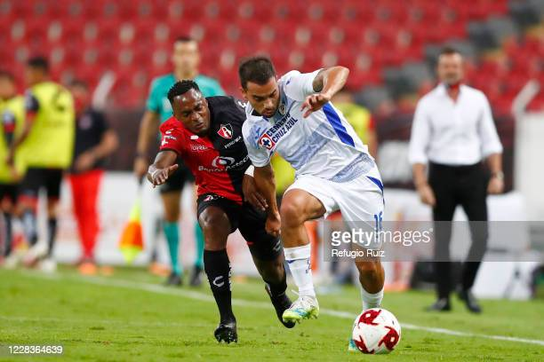 Alex Ibarra of Atlas fights for the ball with Adrian Aldrete of Cruz Azul during the 8th round match between Atlas and Cruz Azul as part of the...