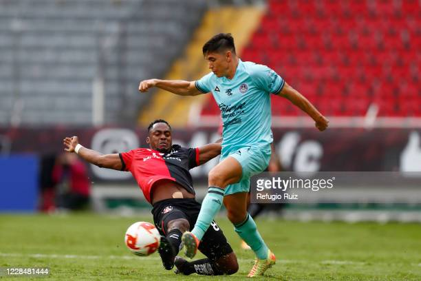 Alex Ibarra of Atlas fights for the ball with Efrain Velarde of Mazatlan during the 10th round match between Atlas and Mazatlan FC as part of the...
