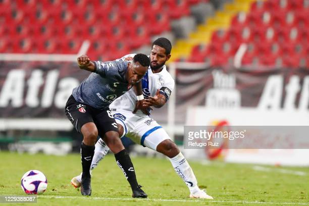 Alex Ibarra of Atlas fights for the ball with Hugo Nervo of Atlas during the 16th round match between Atlas and Puebla as part of the Torneo...