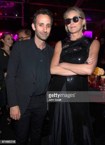 Alex Israel and Sharon Stone at the MOCA Gala 2017 honoring Jeff Koons at The Geffen Contemporary at MOCA on April 29 2017 in Los Angeles California