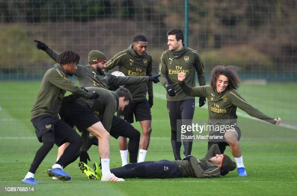 Alex Iwobi Alex Lacazette Laurent Koscielny Ainsley Maitland Niles PierreEmerick Aubameyang and Matteo Guendoudi joke around before a training...