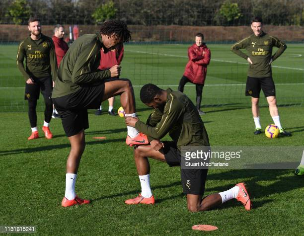 Alex Iwobi and Ainsley MaitlandNiles of Arsenal during a training session at London Colney on February 23 2019 in St Albans England
