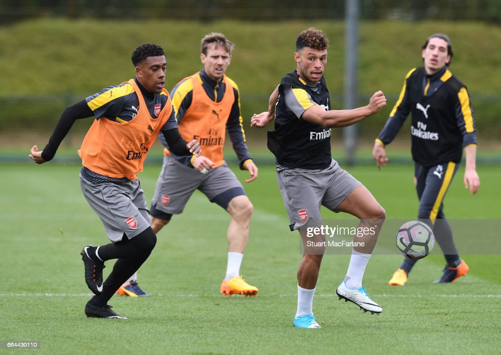 Alex Iwobi and Alex Oxlade-Chamberlain of Arsenal during a training session at London Colney on April 4, 2017 in St Albans, England.