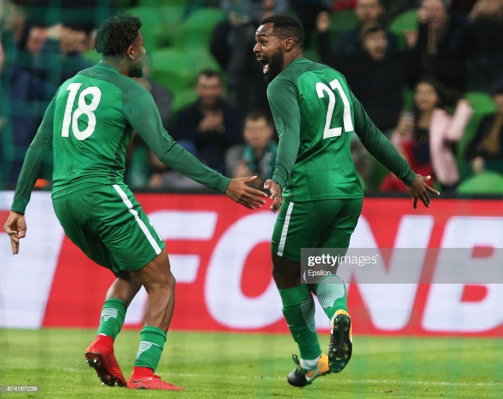 Alex Iwobi (L) and Brian Idowu of Nigeria celebrate a goal during Argentina and Nigeria International friendly match at Krasnodar Stadium on November 14, 2017 in Krasnodar, Russia.