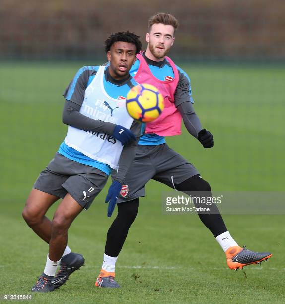 Alex Iwobi and Calum Chambers of Arsenal during a training session at London Colney on February 2 2018 in St Albans England