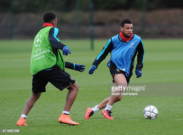 Alex Iwobi and Francis Coquelin of Arsenal during a training session at London Colney on February 22 2016 in St Albans England