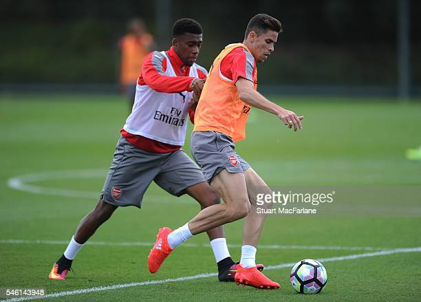 Alex Iwobi and Gabriel of Arsenal during a training session at London Colney on July 11 2016 in St Albans England