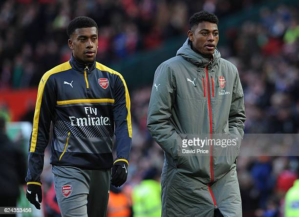 Alex Iwobi and Jeff ReineAdelaide of Arsenal before the Premier League match between Manchester United and Arsenal at Old Trafford on November 19...
