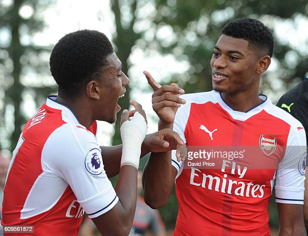 Alex Iwobi and Jeff ReineAdelaide of Arsenal during the Arsenal Squad photos at London Colney on September 21 2016 in St Albans England