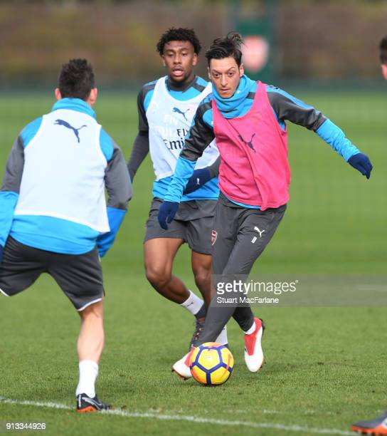 Alex Iwobi and Mesut Ozil of Arsenal during a training session at London Colney on February 2 2018 in St Albans England