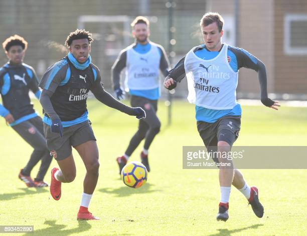 Alex Iwobi and Rob Holding of Arsenal during a training session at London Colney on December 15 2017 in St Albans England